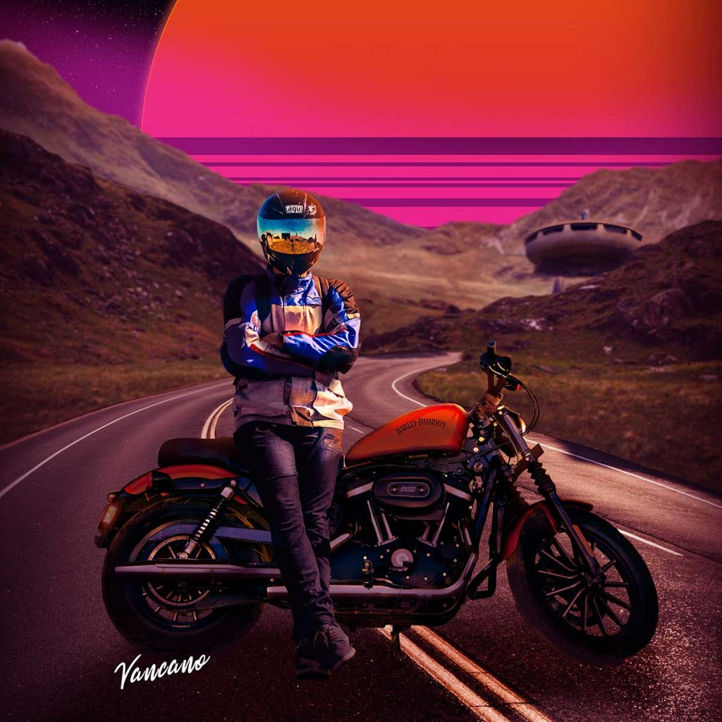 A motorbike is pulled across a road and it's rider sits facing the camera. There is an orange and pink retrowave sun behind mountains.